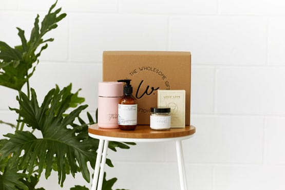 Products arranged on stool in front of gift boxes online